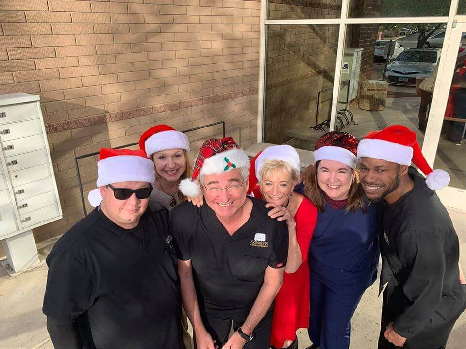 Dr. Kammeyer and staff celebrating the holidays at Solutions Dental Implants in Sun City West, AZ
