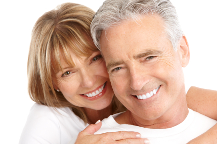 Mature couple smiling and holding each other procedure at Soultions Dental Implants in Sun City AZ